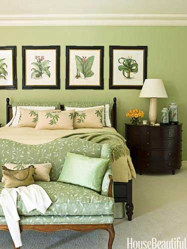 """Traditional Green Bedroom  i love green  Traditional Green Bedroom  In the master bedroom of this Palm Beach home by designer Allison Paladino, a bed from Drexel Heritage's Postobello collection and nightstands by Thomas Pheasant for Baker are """"rich and elegant"""" against walls painted Benjamin Moore's Mesquite. Settee is covered in Cowtan & Tout's Trailing Leaf Linen."""
