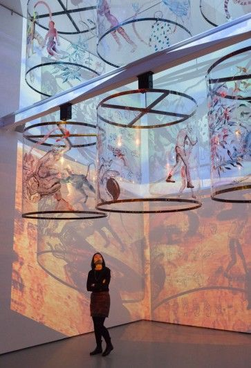 Nalini Malani. Gamepieces. 2003/2009. Four-channel video (color, sound), six acrylic reverse-painted Lexan cylinders. 12 min. The Museum of Modern Art, New York. Gift of the Richard J. Massey Foundation for Arts and Sciences. © 2015 Nalini Malani. Installation view of Scenes for a New Heritage: Contemporary Works from the Collection, The Museum of Modern Art, 2015. Photo: Thomas Griesel