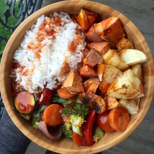 BOMB dot com high carb low fat vegan lunchhhhhh. Rice (more consumed post photo), roasted sweet and white potatoes, vegetables drowned in sweet Chilli sauce).