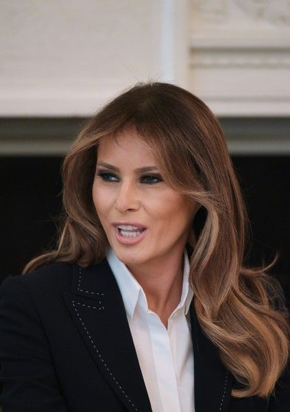 Melania Trump Photos - US First Lady Melania Trump speaks during a round table discussion on opioid abuse in the State Dining Room of the White House on September 28, 2017 in Washington, DC. / AFP PHOTO / Mandel NGAN - Melania Trump Hosts Listening Session On Opioid Crisis At White House