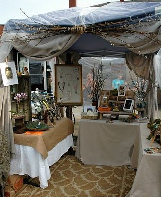 """fairy"" tent at the Alberta Art Hop *note the rug, the swag of twigs and curtains on the sides, makes te difference between a sale and a look I think.  Good Job!!!"