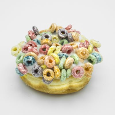 Image of a raised yeast doughnut with vanilla frosting and Fruit Loops.