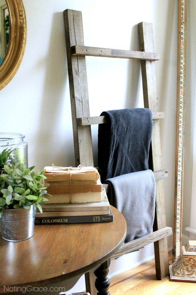 Empty the wicker blanket basket, hang blankets here, use the basket for toys. Make a DIY Blanket Ladder in a Weekend