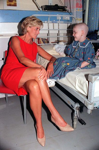July 1997: Diana, Princess of Wales meets Holly Ann Robinson Marsh, who lost her hair as a result of chemotherapy, during her visit to Northwick Park Hospital in London, where she unveiled a foundation stone for a new children's casualty centre.