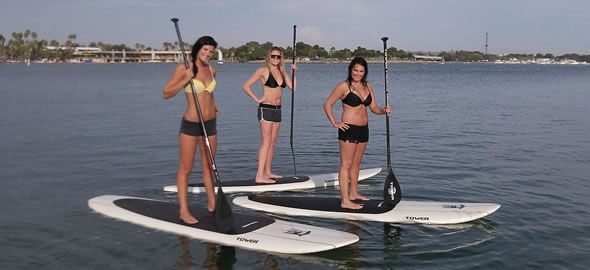3 girls paddle boarding with paddle board rentals in myrtle beach sc