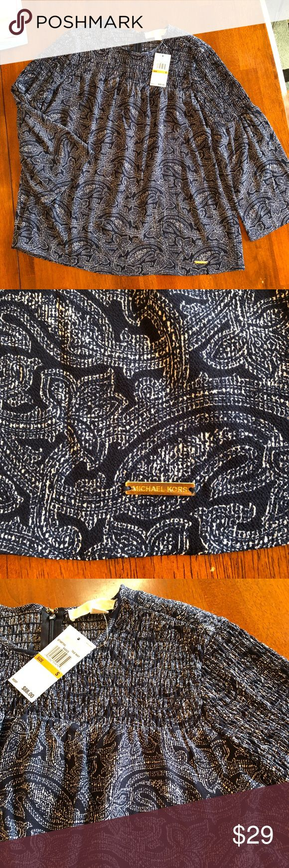 ⭐️ Beautiful Michael Kors top! ⭐️ Michael Kors navy/white paisley print peasant top! This light and flowy semi-sheer top has bell sleeves with puckered stretchy pleats at the neck and into the sleeves. A hidden 1/4 zipper in the back with a hook and eye closure. Beautiful addition to any spring wardrobe!! NWT ⭐️ Michael Kors Tops Blouses