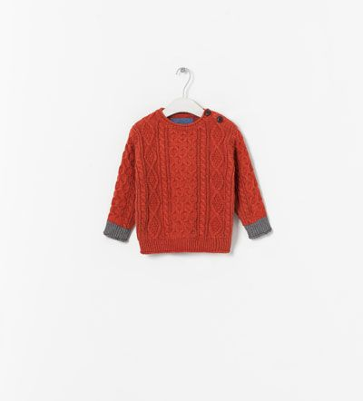 Image 1 of KNITTED SWEATER WITH BUTTONS AT THE SIDE from Zara