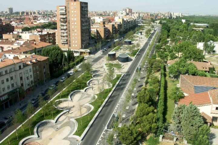 Puente del Rey riverside returned to the people of Madrid by West 8. burying kilometres of motorway and carparks underground enabled huge parks to be placed in the centre of the city.