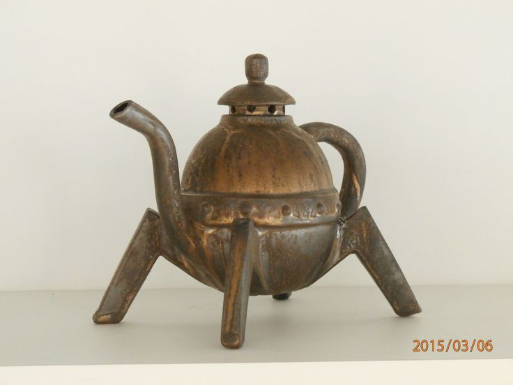 The latest creation of John's hand built paper clay teapot.  One in a series 'Industrial' teapots