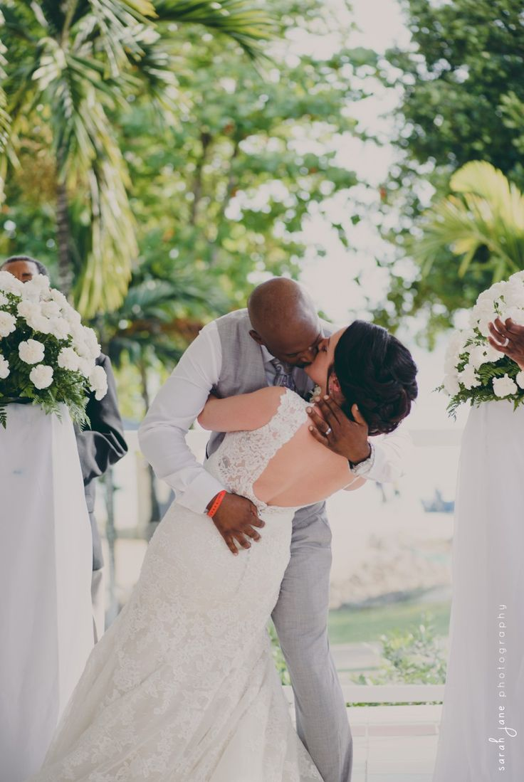 Groom dipping bride for kiss