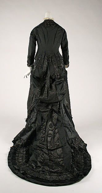Mourning dress  Date: ca. 1880 Culture: French Medium: silk Dimensions: Length at CB (a): 13 in. (33 cm) Length at CB (b): 62 in. (157.5 cm) Credit Line: Gift of Mrs. R. Thornton Wilson (deceased) through her husband (offered in accordance with the wishes of the donor), 1943 Accession Number: 43.72.1a, b