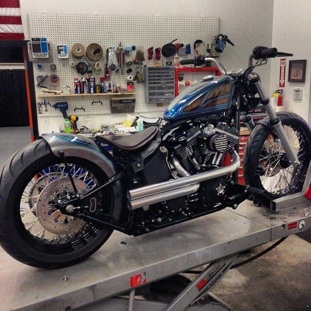 Harley Nightrain softail custom with short shotgun mid-exhaust, black rims and sportster tank