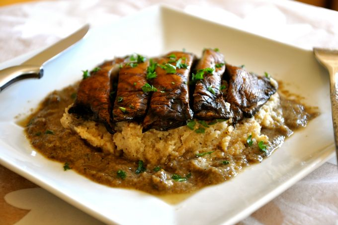 Grilled Portobello Mushrooms over Mashed Cauliflower Smothered in Gravy - Vegan comfort food