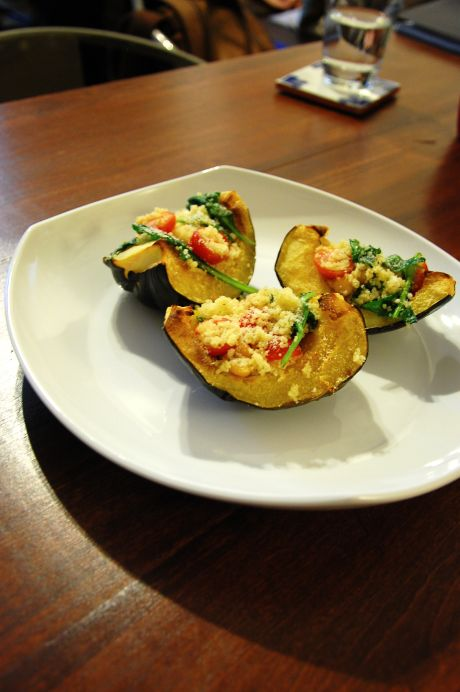 Stuffed acorn squash with couscous and parmesan