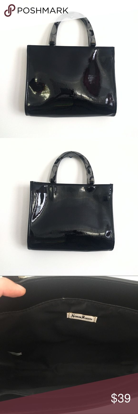 """Neiman Marcus Black Patent Leather Handbag Neiman Marcus Black Patent Leather Handbag   * Chic and elegant tote bag features marble look handles. In great condition with one minor scratch.  * Approximate measurements: L: 11-1/8"""", H: 8-3/4"""", Handle: 5-1/4"""", Opens: 7""""  📦 Bundle + save on shipping  📫 Same day shipping M-F 🚫 NO TRADES Neiman Marcus Bags"""