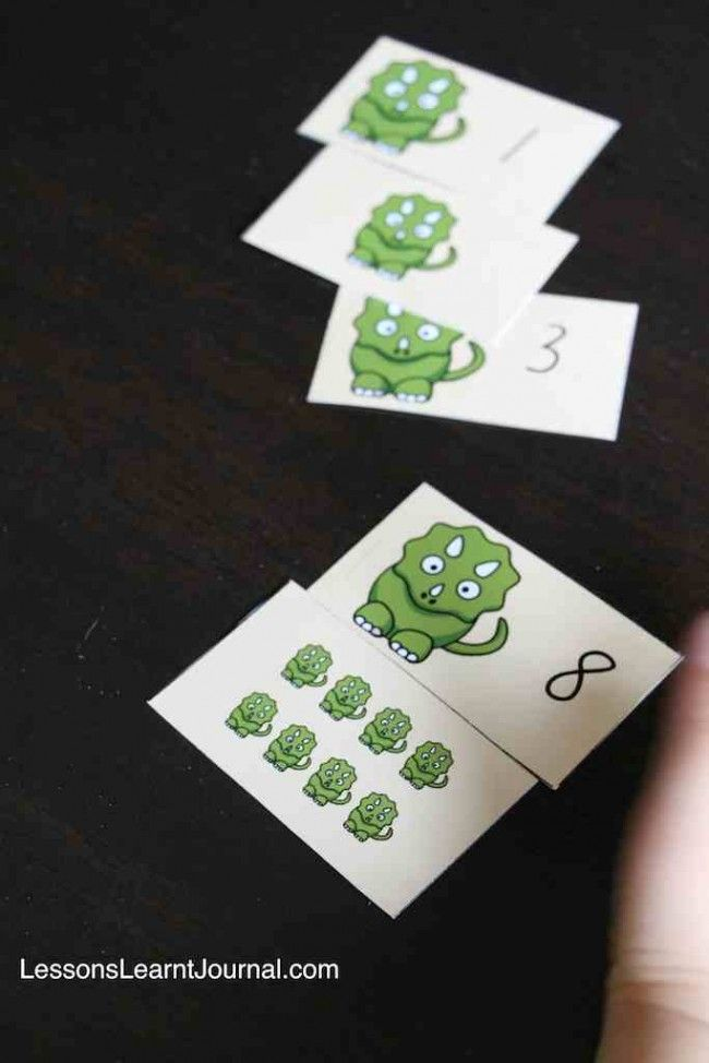 A fun math game to develop early numeral identification and counting skills. Includes free printable cards. #lessonslearntjournal #mathgames #counting #numerals