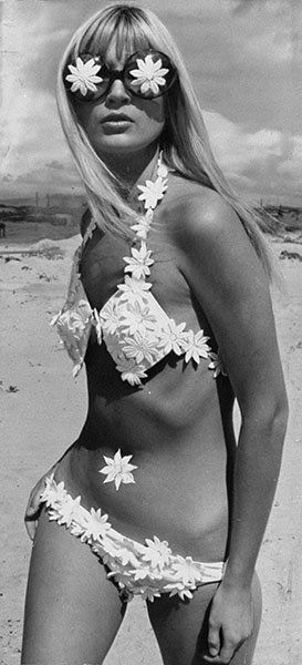 Late '60s - This gal is taking the Flower Child thing a bit literally, but the late 1960s was a time for liberation. Enter: the skimpier bikini. Hippies and entertainers alike (Cher was a big fan in her early days) began rocking bikini tops as a sexier answer to separates.
