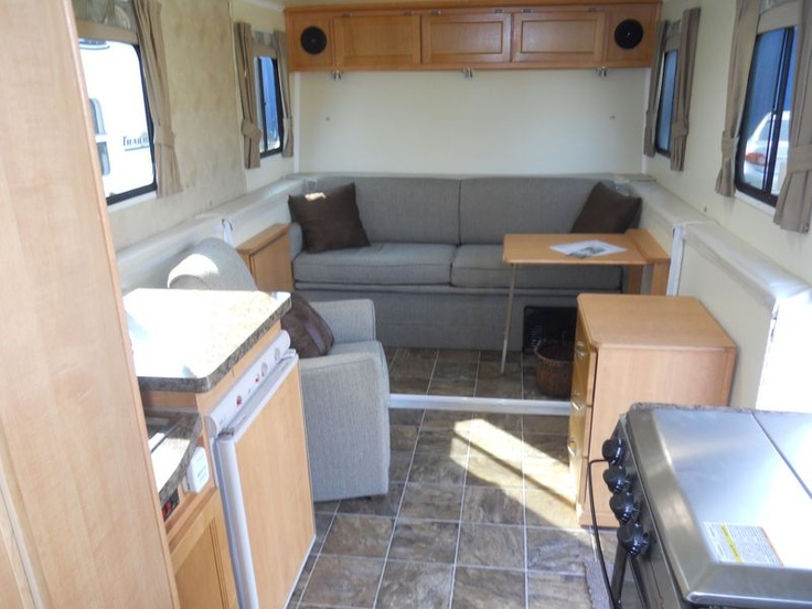 TrailManor 2720SL inside view of sofa with easy chair and