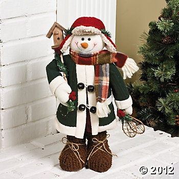 "Standing Snowman with Birdhouse. This character is fully dressed and ready for winter fun. For decorative use only. 19""H.  $20.00 Each"