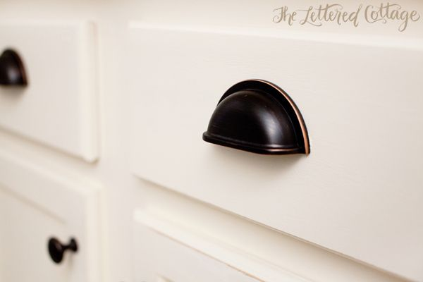 Navajo white paint cabinets oil rubbed bronze cup pulls for White kitchen cabinets with oil rubbed bronze hardware