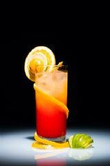 '57 CHEVY!  Ingredients  1 oz. Southern Comfort   1 oz. Crown Royal  1 oz. Amaretto  Pineapple Juice  Orange Juice  1 splash(es) Grenadine  Instructions  Fill a highball glass with ice and pour in the liqueurs. Fill the rest of the glass with equal parts of the juices and top off with a splash of grenadine. Cover the glass with a shaker and shake well. Remove shaker from glass and serve.