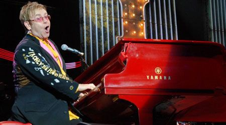 Elton with his famous red piano! I really want to see him this Fall for his show in Las Vegas!!!