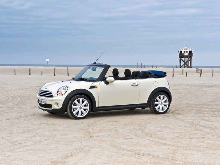 a white mini cooper convertible