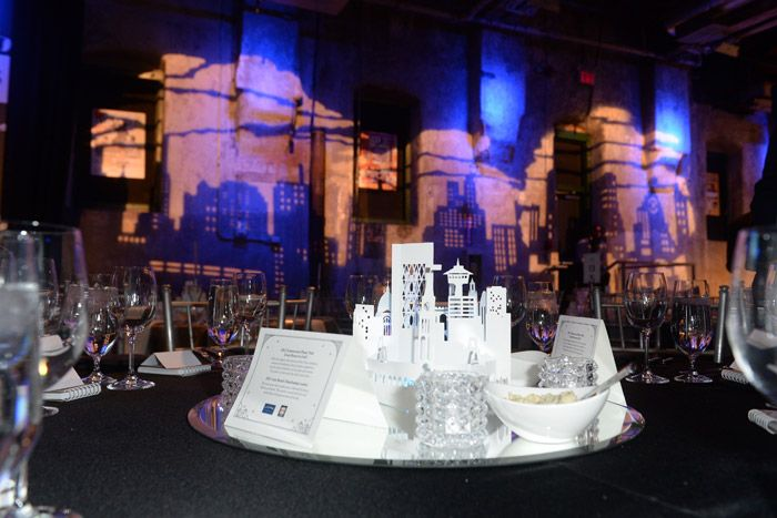 Use it as a Centerpiece: At the Walrus Foundation Gala, tabletops were decked with miniature renderings of the Toronto skyline, created in paper by artist Kalpna Patel.
