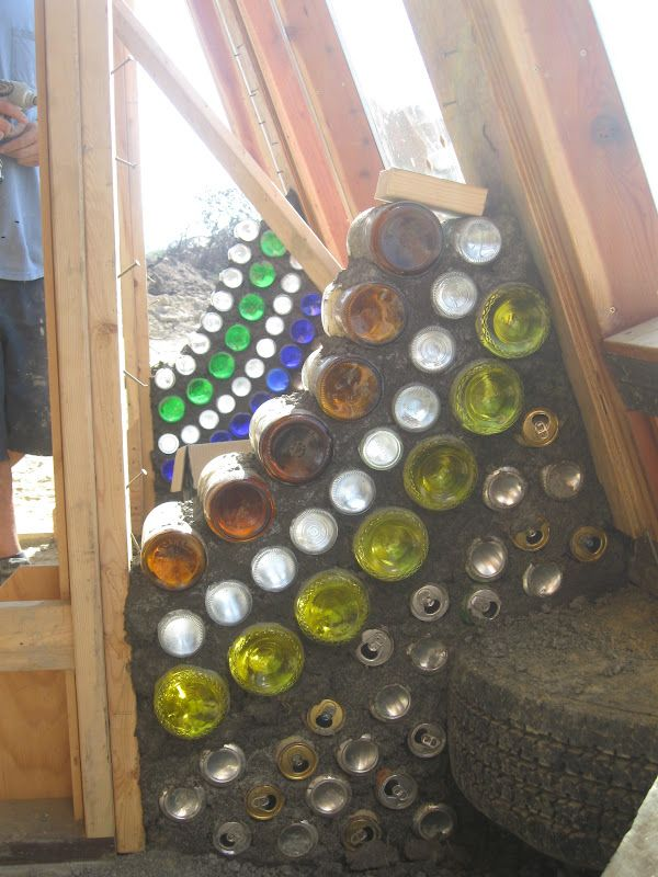 bottle wall, what a great idea for the garden, the empty can would make nice bug homes!