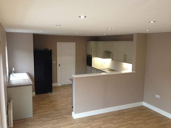Love the half wall to divide the kitchen space but keep it looking light and open.