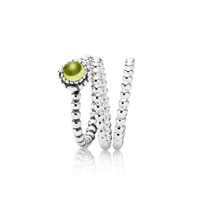 green peridot ring stacked with two silver rings i dig this