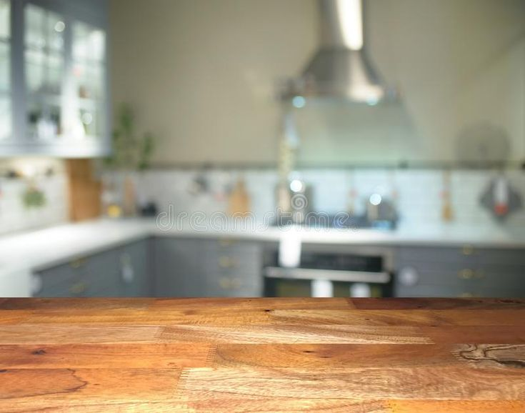 Empty wooden display table top front with blurred kitchen ...