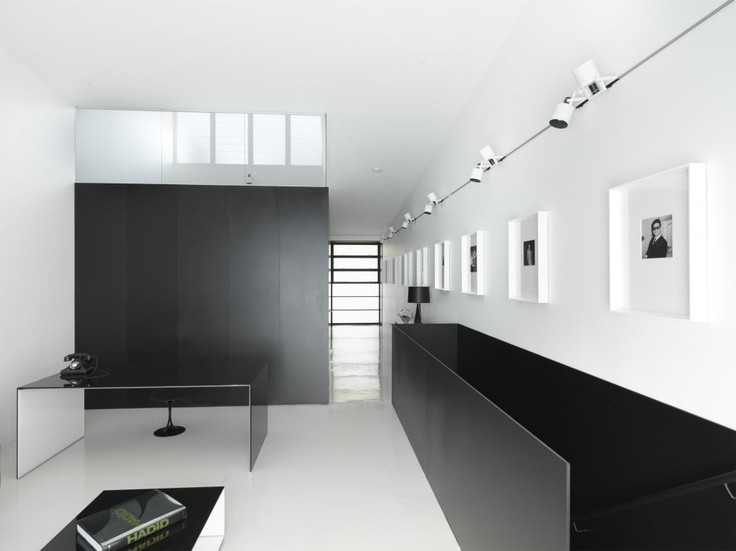 White architecture with black interior elements. The study of the Strelein Warehouse by Ian Moore Architects.