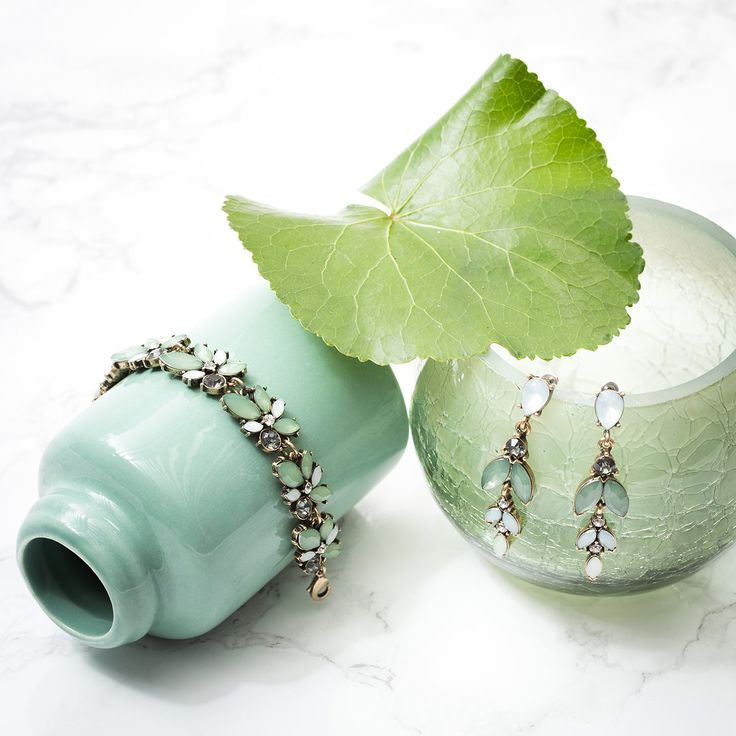 It's a match! These two show us how beautifully shades of green go with antique gold. Bring on the spring!