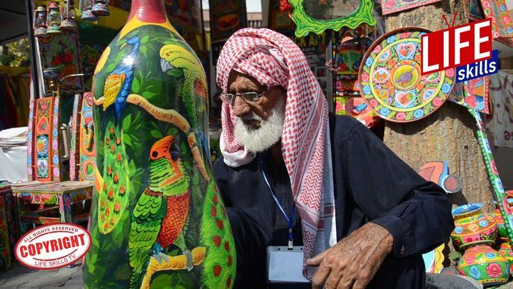 Pakistani Truck Artist working in Lokversa Mela (Truck Art in Pakistan)I...