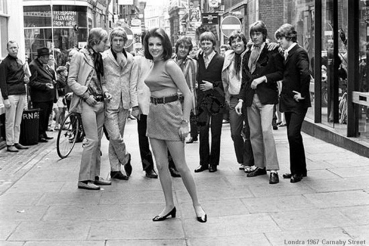 Mod guys eyeing up a girl in a mini skirt Carnaby Street 1967