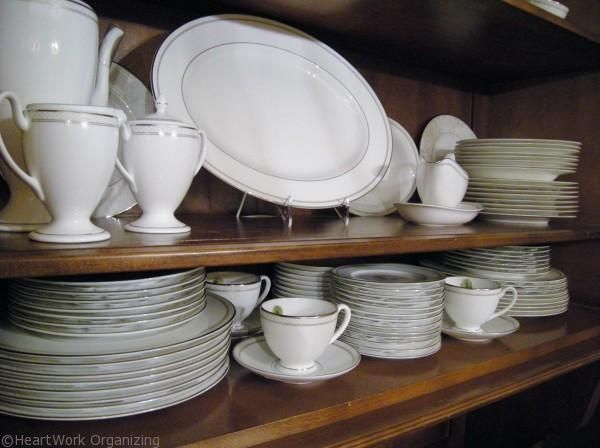 How to arrange a china cabinet china for Arranging dishes in kitchen cabinets