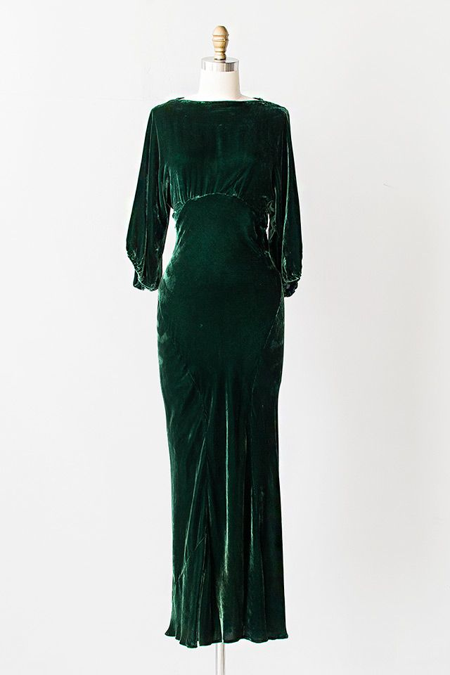Vintage 1930s green silk velvet gown features cream and green silk flowers clustered along the open cut out back.