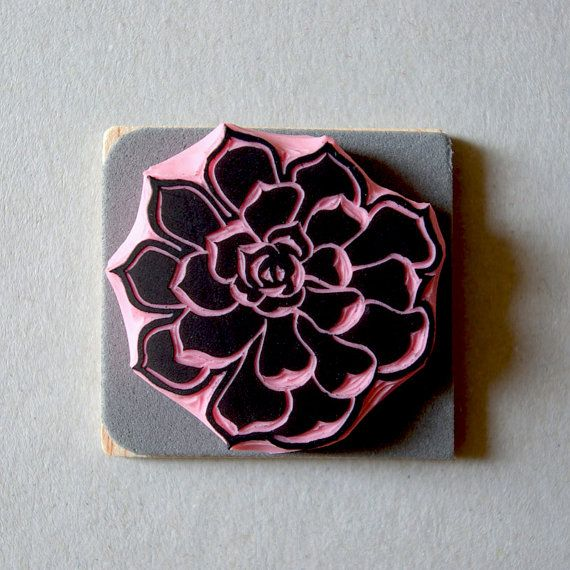 Hand carved rubber stamp of a succulent flower.