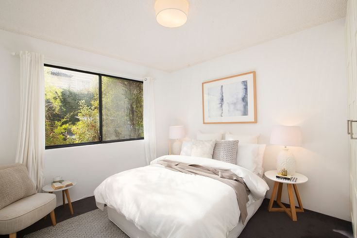 'Harbour Views' apartment with parking, double bedroom, built ins, wall art, side tables, lamps, styled, sitting chair, leafy outlook, Pilcher Residential