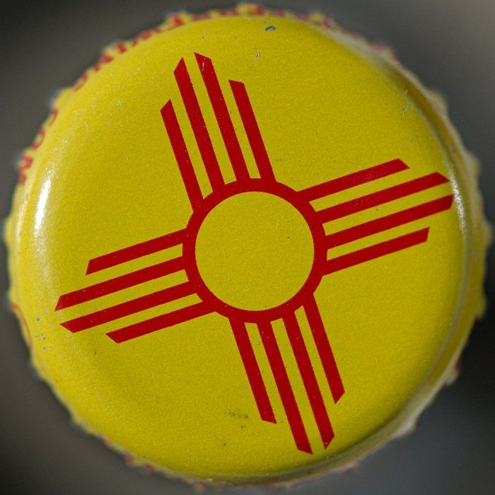 Zia sun symbol      also on the state flag of New Mexico