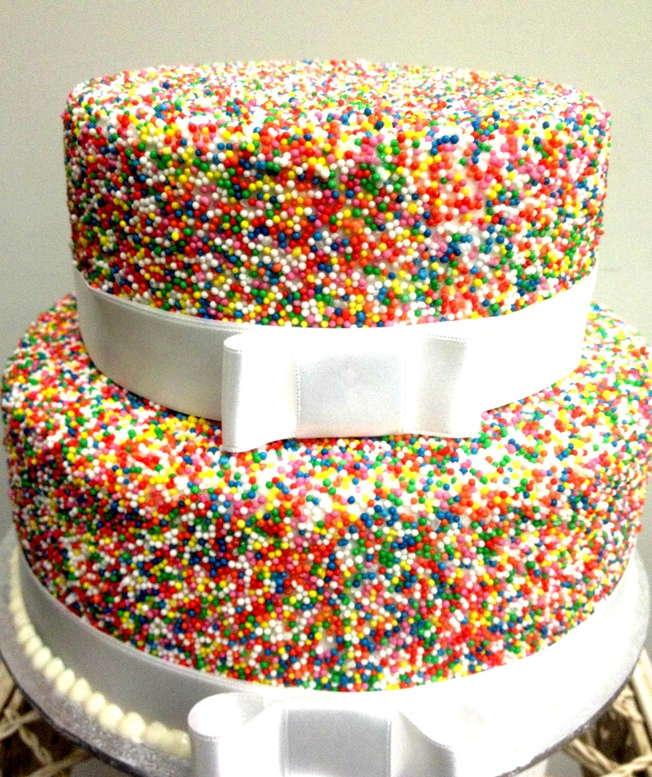 A fun cake that is colourful and happy.