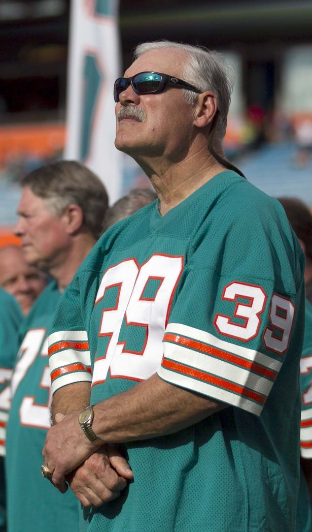 Former Dolphins running back Larry Csonka takes part in the halftime ceremony honoring the 1972 perfect season team at Sun Life Stadium in Miami Gardens, Florida on December 16, 2012. (Allen Eyestone/The Palm Beach Post)