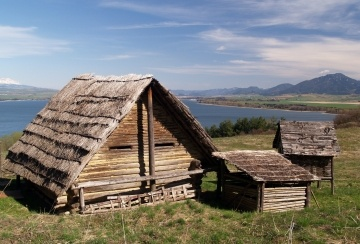 Ancient wooden houses in the outdoor archeological museum of Celtic culture located in Havranok near Liptovska Mara lake in Slovakia.