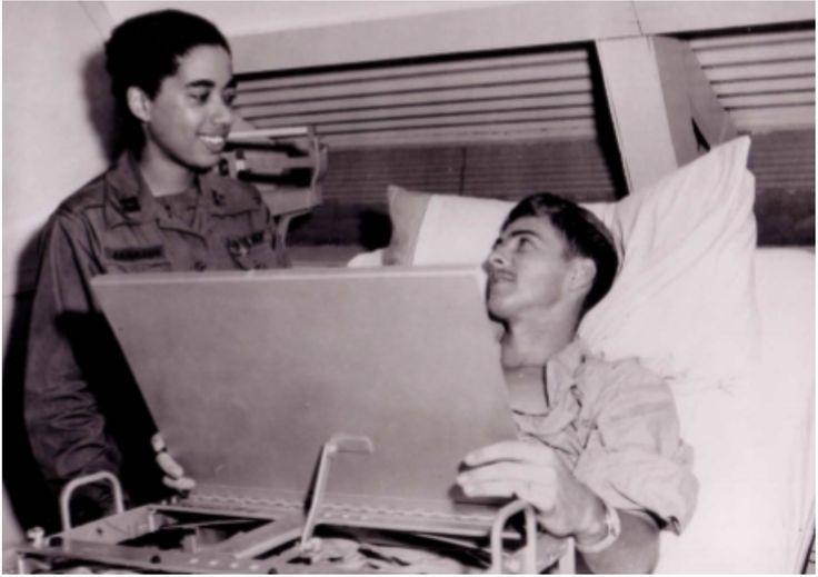 Army nurse Captain Joyce Johnson treats a patient at Long Binh in 1967.