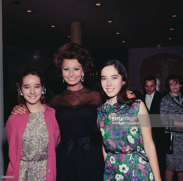 Italian actress Sophia Loren pictured in centre with Charlie Chaplin's daughters Victoria Chaplin (left) and Josephine Chaplin (right) at the Savoy Hotel in London on 1st November 1965.