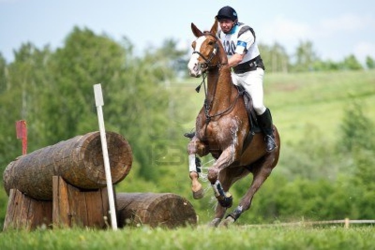 """JUNE 02  Unidentified rider on horse is overcomes the obstacle at the International Eventing Competition CCI3  2  1  """"Russian Cup Eventing"""" June 02, 2012 in Moscow, Russia"""