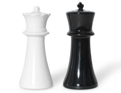 Checkmate Salt n Pepper Shakers  Ceramic salt and pepper shakers.   On the dinning table, salt and pepper are a traditionally paired set of condiments used to enhance the flavor of many European dishes. Like the chess pieces, salt and pepper shakers are matched in a set, with white indicating salt and black for pepper. Often the queen gets an extra shake more than the king, but both are essential to completing a meal.$54.95.