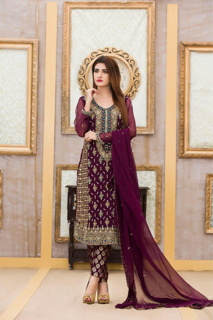 Make your collection more attractive and charming with this glorious embroidered bridal dress.Chiffon shirt adorned rich and magnificent embellishment hand embroidery and dabka work all over. The dress is accompanied with a purple dupatta. The material in the shirt is pure chiffon and bottom is jamawar. Jamawar trim is adding a spark in the dress. Order now will give you very divine and angelic look on the wedding and special occasions.FABRIC:SHIRT: PURE CHIFFONBOTTOM:JAMAWARDUPPATTA:PURE…