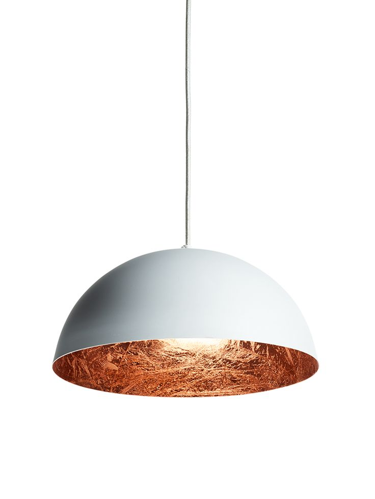 With a soft white outside and copper leaf inside, our dome pendant light is sure to make an eye-catching statement, whether hung in your kitchen or dining room. The copper leaf inside this statement shade reflects the light to give a soft, warm glow when lit. Click here to view our useful lighting buying guide, and take a look at our blog for ideas on how incorporate lighting into your home.